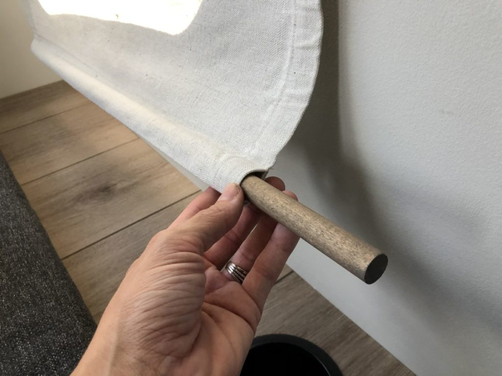 DIY. R.v. Curtain panel that roll up with a leather strap.